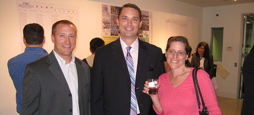 Alumni Chris Barry, Josh Ooyman, and Jennifer Rosenberg enjoy SURP's 20th Anniversary celebration.